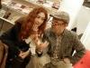 Indrė Valantinaitė ir Rolandas Rastauskas šnekučiuojasi Vilniaus knygų mugėje. 2011 vasario 19 d.