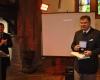 R.Jarockis įteikia KM ženklą M.Daniui
