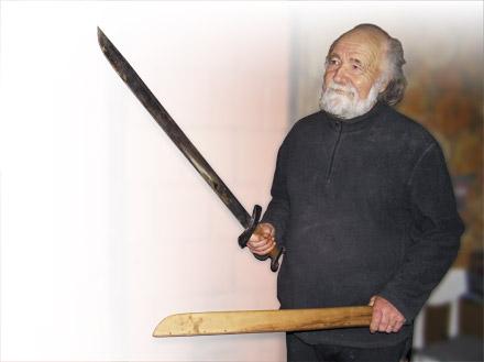 V.Almanis su kalaviju