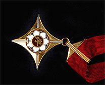 """Auksinis scenos kryžius. """"Wikipedia"""" nuotr."""