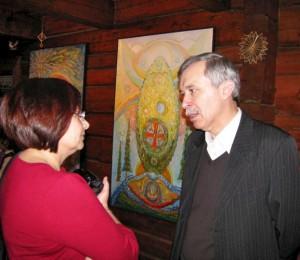 Dailininkas V.Kašinskas pristato paveiksklus | E.Vindašienės nuotr.