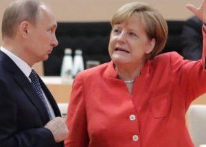 Vladimiras Putinas ir Angela Merkel | Youtube nuotr.